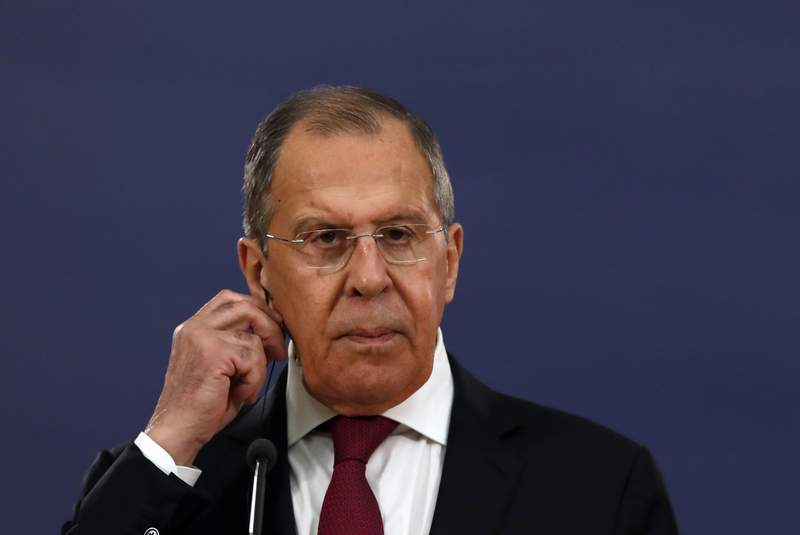 Russian Foreign Minister Sergey Lavrov listens as Serbia's President Aleksandar Vucic speaks during a joint press conference in Belgrade, Serbia, Thursday, June 18, 2020. Lavrov is on a two-day official visit to Serbia. (AP Photo/Darko Vojinovic)