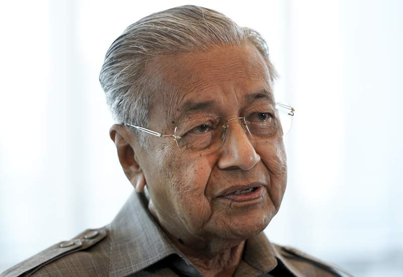 FILE - In this Sept. 4, 2020, file photo, former Prime Minister Mahathir Mohamad speaks during an interview with The Associated Press in Kuala Lumpur. Mahathir said Friday, Oct. 30, 2020, he is disgusted because his comments on attacks by Muslim extremists in France had been taken out of context. (AP Photo/Vincent Thian, File)
