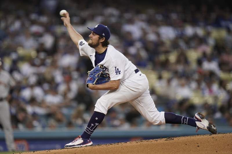Los Angeles Dodgers starting pitcher Trevor Bauer throws against the San Francisco Giants during the third inning of a baseball game, Monday, June 28, 2021, in Los Angeles. (AP Photo/Jae C. Hong)