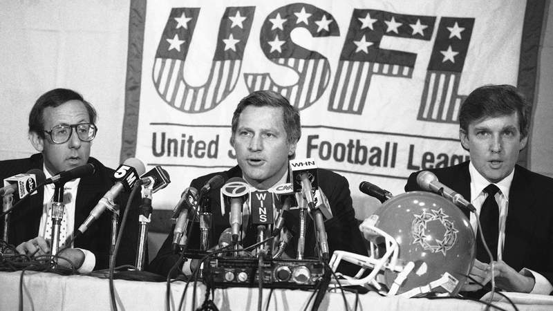 In this Aug. 2, 1985, file photo, Trump and Ross, left, and USFL Commissioner Harry L. Usher, center, discuss the agreement reached to merge the Houston and New Jersey franchises.