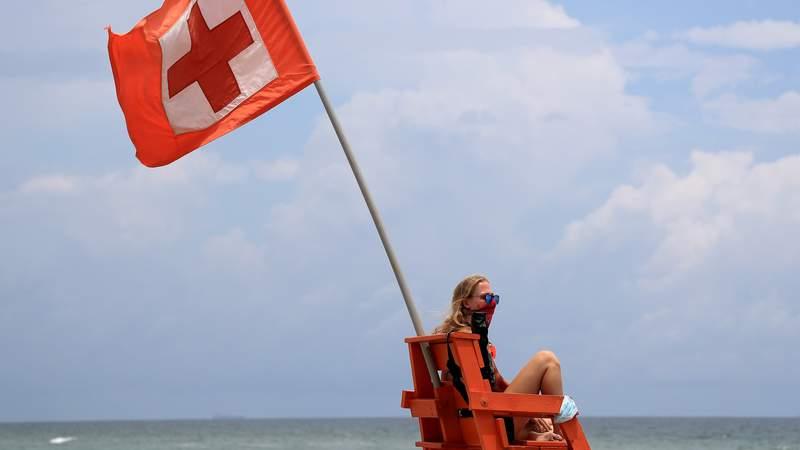 A lifeguard surveys Jacksonville Beach.