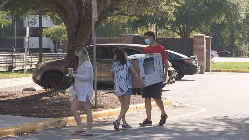 Pandemic protocols: College students under new process for move-in day