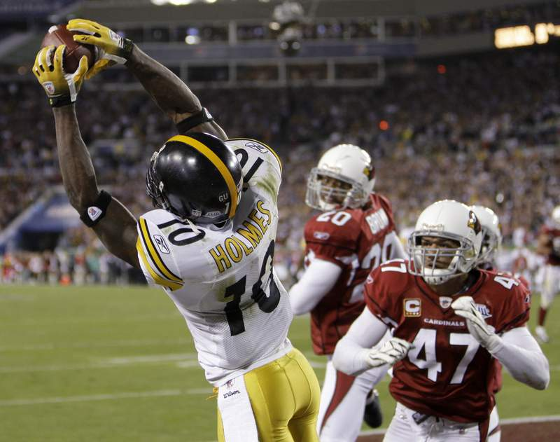 FILE - In this Feb. 1, 2009, file photo, Pittsburgh Steelers wide receiver Santonio Holmes(10) catches a touchdown pass as Arizona Cardinals' Aaron Francisco (47) and Ralph Brown watch during the fourth quarter of NFL football's Super Bowl XLIII in Tampa, Fla. The Steelers won 27-23, (AP Photo/Chris O'Meara, File)