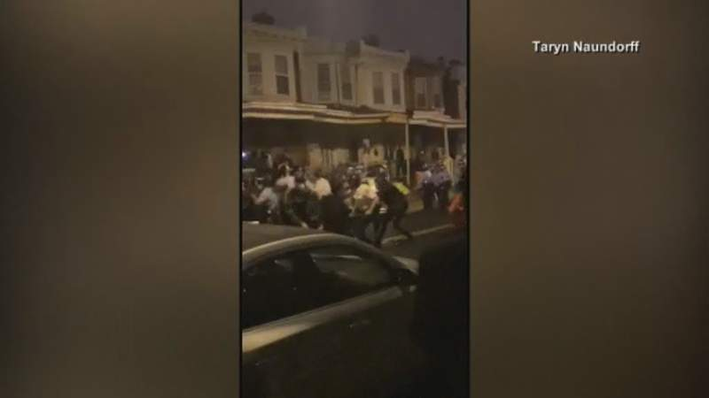 Police shot and killed a 27-year-old Black man on a Philadelphia street after yelling at him to drop his knife, sparking violent protests that police said injured 30 officers and led to dozens of arrests.