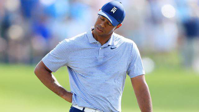 Tiger Woods reacts after a quadruple bogey on the 17th hole during the second round of The Players Championship on The Stadium Course at TPC Sawgrass on Thursday. (Photo by Sam Greenwood/Getty Images)