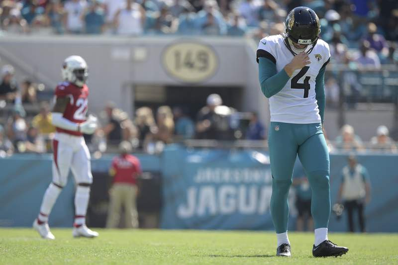 Jacksonville Jaguars kicker Josh Lambo (4) walks on the field to kickoff to the Arizona Cardinals after missing an extra point attempt during the second half of an NFL football game, Sunday, Sept. 26, 2021, in Jacksonville, Fla. (AP Photo/Phelan M. Ebenhack)