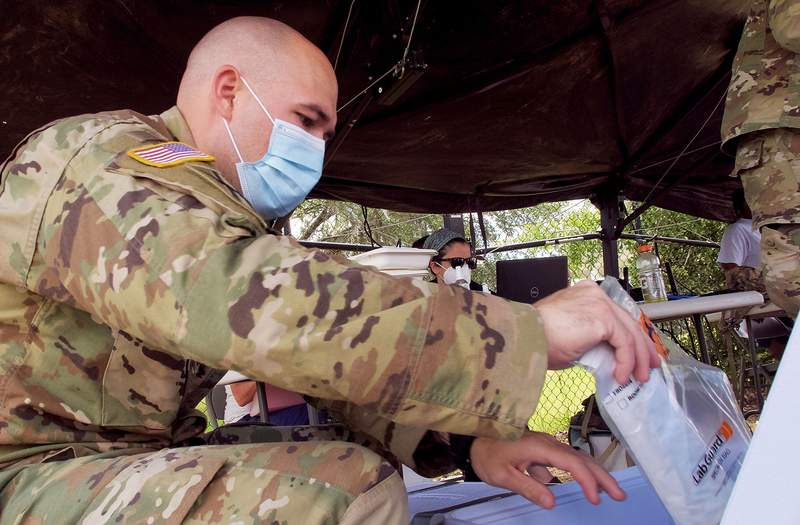 U.S. Army Sgt. 1st Class Warren Lowry, 48th Infantry Brigade Combat Team, Georgia National Guard, at a COVID-19 testing site in Albany.