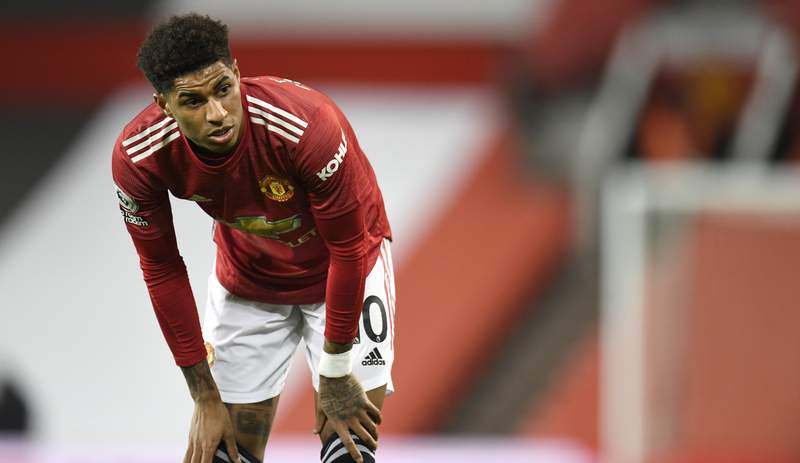Manchester United's Marcus Rashford rests during the English Premier League soccer match between Manchester United and West Ham United at Old Trafford, Manchester, England, Sunday, March. 14, 2021. (AP Photo/Peter Powell,Pool)