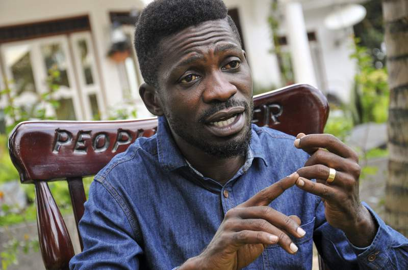 FILE - In this Friday, March 27, 2020 file photo, Ugandan musician, lawmaker and presidential aspirant Bobi Wine, whose real name is Kyagulanyi Ssentamu, speaks to The Associated Press in Kampala, Uganda. Police in Uganda have confronted opposition presidential candidate Bobi Wine during an online press conference, and he says they fired tear gas and bullets as they swarmed his car. Journalists watched Thursday, Jan. 7, 2021 as an officer appeared to drag Wine from the car while he pleaded that he had broken no law. (AP Photo/Ronald Kabuubi, File)