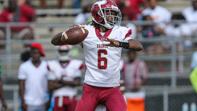 Raines quarterback Carleton Butler throws a pass during a game against Ribault on Oct. 12. (Gary Lloyd McCullough, for News For Jax)