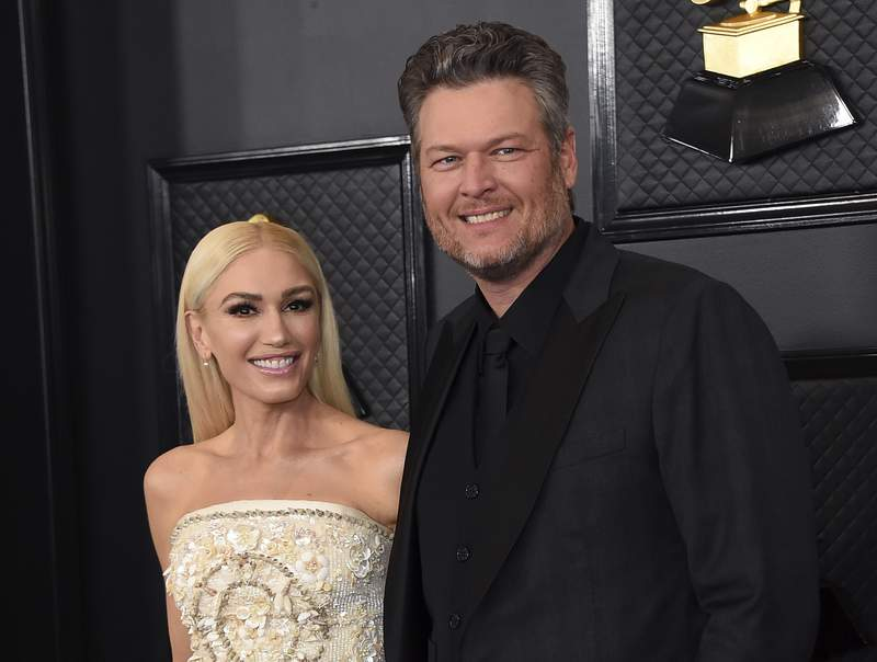 FILE - In this Jan. 26, 2020, file photo, Gwen Stefani, left, and Blake Shelton arrive at the 62nd annual Grammy Awards in Los Angeles. The Voice coaches Stefani and Shelton celebrated their nuptials over the Fourth of July holiday during a weekend wedding in Oklahoma. Images were posted Monday, July 5, 2021, of their wedding. (Photo by Jordan Strauss/Invision/AP, File)