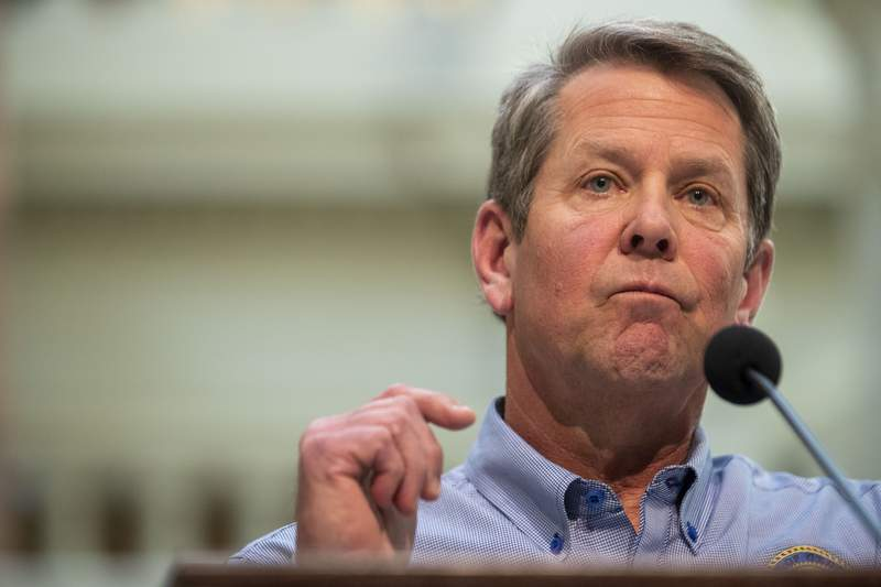 Georgia Gov. Brian Kemp speaks during a news conference at the Capitol building in Atlanta, Monday, April 27, 2020, during the coronavirus outbreak. Kemp did not say whether he would extend the shelter-in-place order that is set to expire at midnight Thursday. (Alyssa Pointer/Atlanta Journal-Constitution via AP)