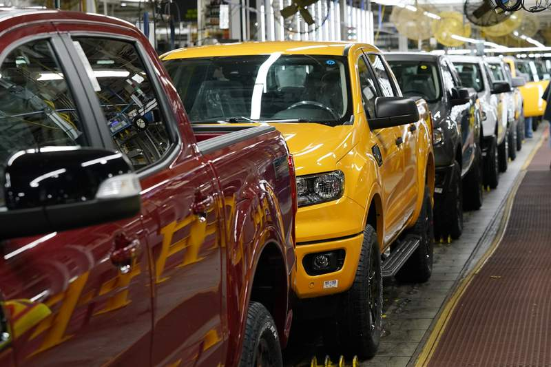 Model year 2021 Ford Ranger trucks on the assembly line at Michigan Assembly, Monday, June 14, 2021, in Wayne, Mich. Surging output of cars, trucks and auto parts pulled U.S. factory production up 0.9% in May. Adding utilities and mines, overall U.S. industrial production climbed 0.8% in May from April, the Federal Reserve reported Tuesday.  (AP Photo/Carlos Osorio)