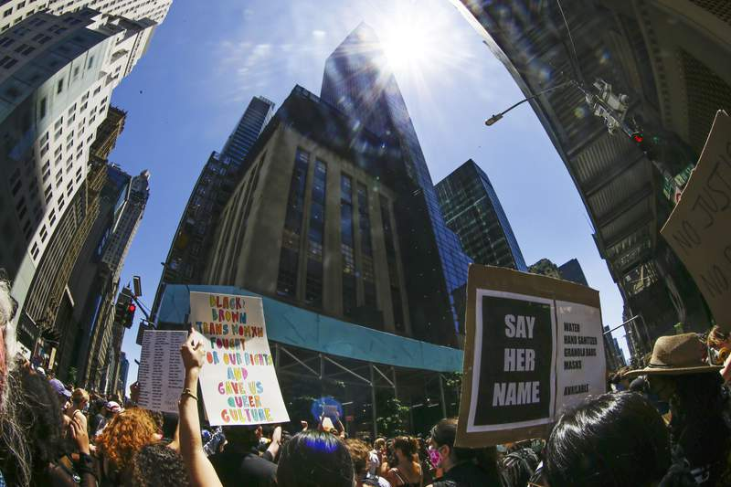 Protesters gather near Trump Tower as part of a solidarity rally calling for justice over the death of George Floyd, and to highlight police brutality nationwide, Friday, June 12, 2020, in New York. (AP Photo/Frank Franklin II)