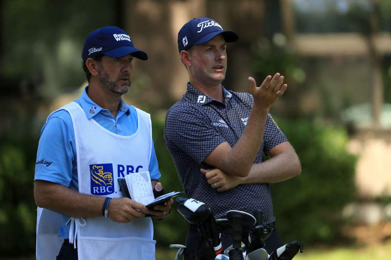 Webb Simpson talks with his caddie Paul Tesori, a St. Augustine native, on the 12th tee during the first round of the RBC Heritage on June 18, 2020 at Harbour Town Golf Links in Hilton Head Island, South Carolina. (Photo by Streeter Lecka/Getty Images)