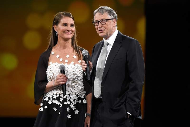 NEW YORK, NY - MAY 14:  Melinda Gates and Bill Gates speak on stage during The Robin Hood Foundation's 2018 benefit at Jacob Javitz Center on May 14, 2018 in New York City.  (Photo by Kevin Mazur/Getty Images for Robin Hood)