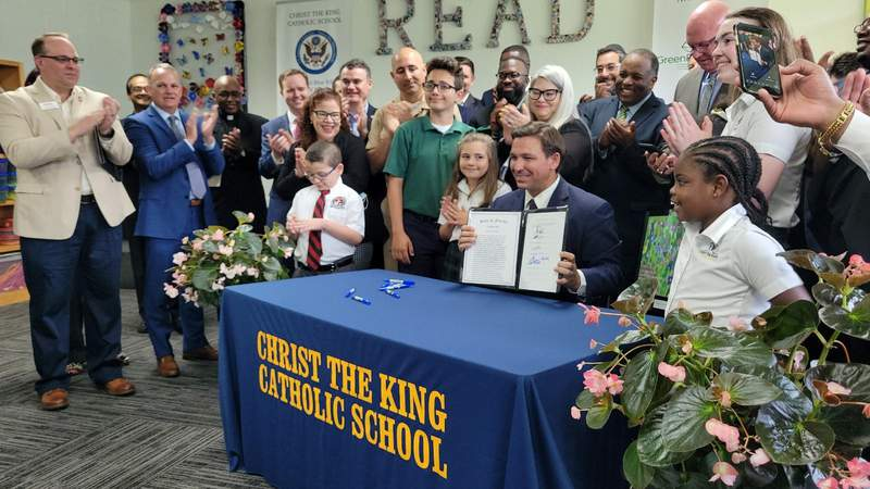 On Tuesday, Florida Gov. Ron DeSantis stopped by Christ the King Catholic School in Jacksonville to sign House Bill 7045.