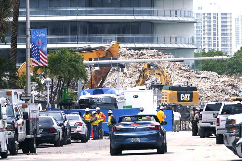 Crews work in the rubble of the Champlain Towers South building on Tuesday, July 13, 2021, in Surfside, Fla. (AP Photo/Lynne Sladky)