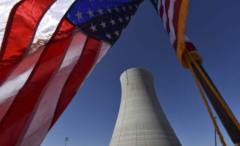 An American flag flies on a construction site at Alvin W. Vogtle Electric Generating Plant, a nuclear power plant, in Waynesboro, Ga.