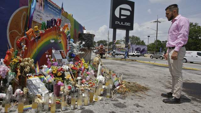 Marco Quiroga, who works to support LGBTQ and social-justice causes in central Florida, reflects in front of one of the memorials at the Pulse Nightclub in Orlando.