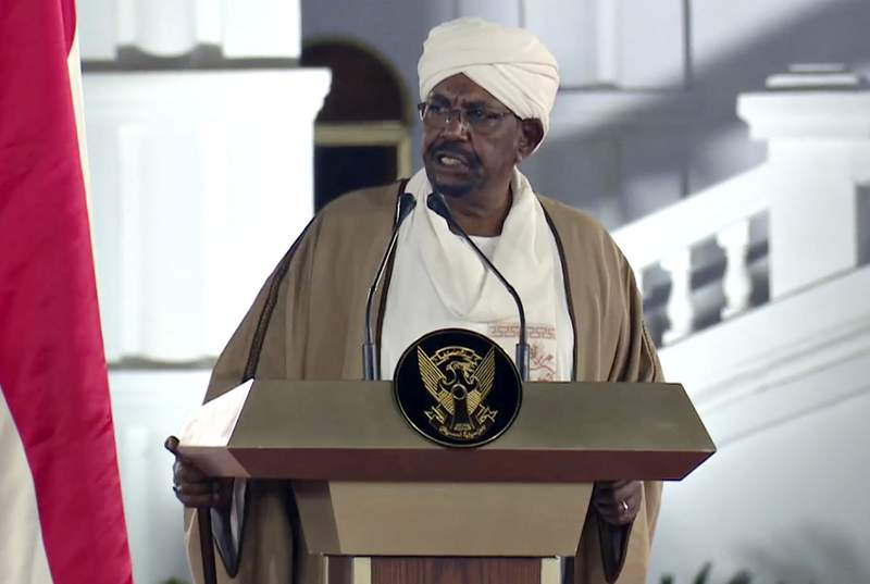 In this image taken from video, Sudan's President Omar al-Bashir speaks at the Presidential Palace, Friday, Feb. 22, 2019, in Khartoum, Sudan. Sudans justice minister on Saturday, Feb. 6, 2021 met with officials from the International Criminal Court in the capital of Khartoum to discuss cooperation with the tribunal in the trials related to the Darfur conflict, his office said. The ICC charged al-Bashir with war crimes and genocide for allegedly masterminding the campaign of attacks in Darfur. (AP Photo/Mohamed Abuamrain)