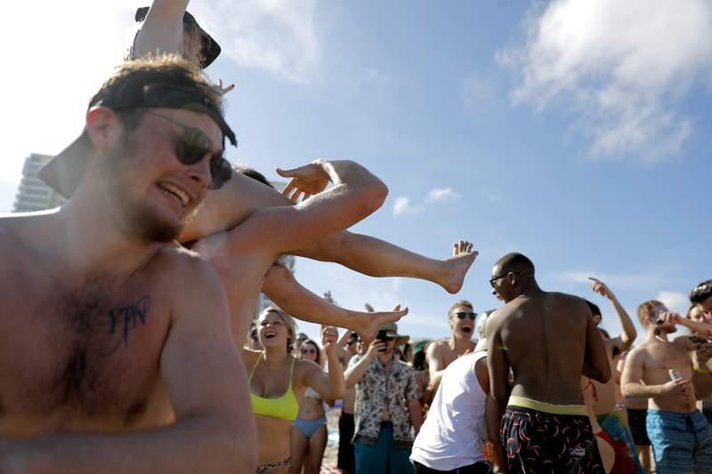 Spring break revelers party on the beach in March in Pompano Beach. (AP Photo/Julio Cortez)