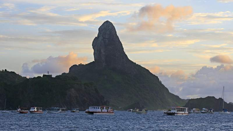 FILE - This June 5, 2009 file photo shows the Fernando de Noronha island in northeast Brazil. Four tourists were arrested on Oct. 29, 2020 for allegedly falsifying COVID-19 tests in an attempt to reach Fernando de Noronha island, which some say is the worlds most beautiful beach, according to a statement on the archipelagos official website. (AP Photo/Eraldo Peres, File)