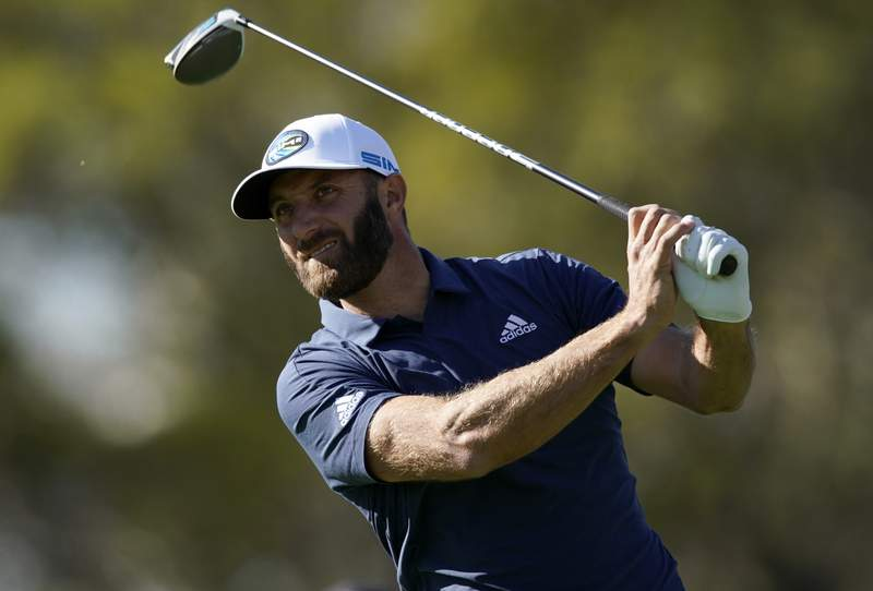 Dustin Johnson tees off on the 17th hole during the first round of the Genesis Invitational golf tournament at Riviera Country Club, Thursday, Feb. 18, 2021, in the Pacific Palisades area of Los Angeles. (AP Photo/Ryan Kang)