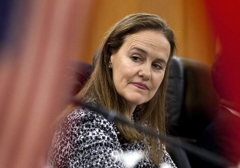 FILE - This Dec. 7, 2011 file photo shows former U.S. Defense Undersecretary Michele Flournoy, preparing for a bilateral meeting in Beijing, China. Flournoy, a politically moderate Pentagon veteran, is regarded by U.S. officials and political insiders as a top choice for President-elect Joe Bide to choose to head the Pentagon. (AP Photo/Andy Wong, File)