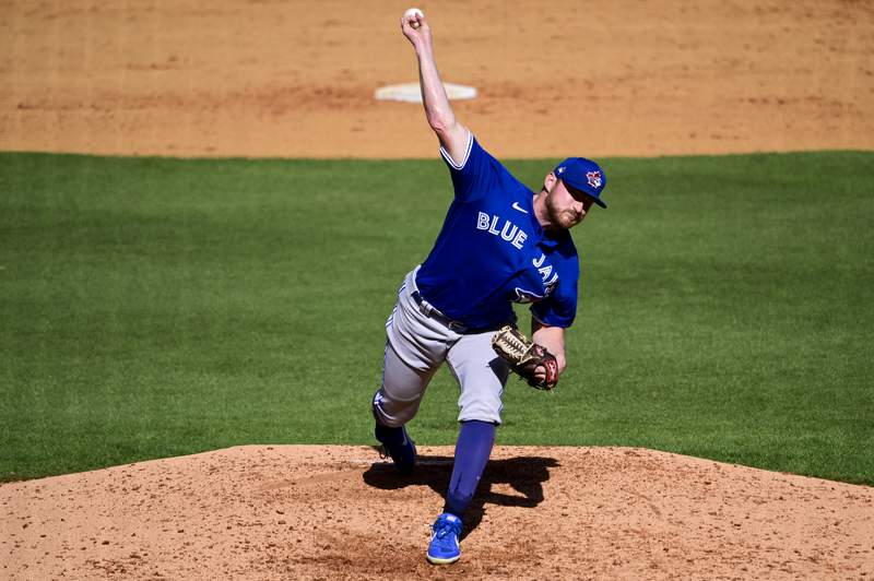 Bryan Baker of the Toronto Blue Jays throws a pitch during the seventh inning against the New York Yankees during a spring training game at George M. Steinbrenner Field on February 28, 2021 in Tampa, Florida. (Photo by Douglas P. DeFelice/Getty Images)