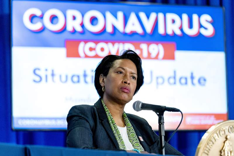 FILE - In this March 15, 2021, file photo, Washington Mayor Muriel Bowser takes a question during a coronavirus update at a news conference in Washington. Bowser announced April 26, that she is relaxing a number of COVID-19 restrictions after more than a year of virus lockdown. (AP Photo/Andrew Harnik, File)