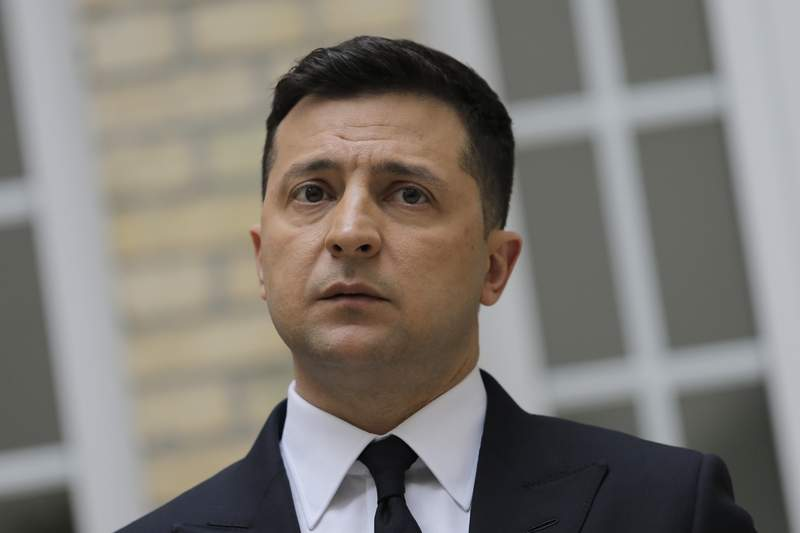 Ukrainian President Volodymyr Zelenskyy looks on during a press conference at the Ukrainian Embassy to France, Friday, April 16, 2021, in Paris. Ukrainian President Volodymyr Zelenskyy held talks with French President Emmanuel Macron and German Chancellor Angela Merkel amid his country's growing tensions with neighboring Russia, which has deployed troops near its border with Ukraine. (AP Photo/Lewis Joly)