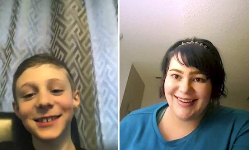 In this April 15, 2020, photo, Sara Herlevsen, right, tutors nine-year-old Corban Music on topics from Vikings to ghosts over a Zoom video conference call in Calgary, Alberta. Herlevsen offers free online lessons to help parents and their children during the coronavirus pandemic. (Jessie Wardarski/Zoom via AP)