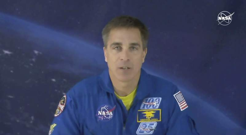 In this image from video made available by NASA, astronaut Chris Cassidy speaks during an interview from cosmonaut headquarters in Star City, Russia, on Thursday, March 19, 2020. Cassidy, who's about to leave the planet for six months, is stressed about coronavirus like everyone else, even though he's already in heavy quarantine. Cassidy said Thursday that when you're an astronaut three weeks away from launch, lots of people are very concerned about your health. He's grateful for that. (NASA via AP)