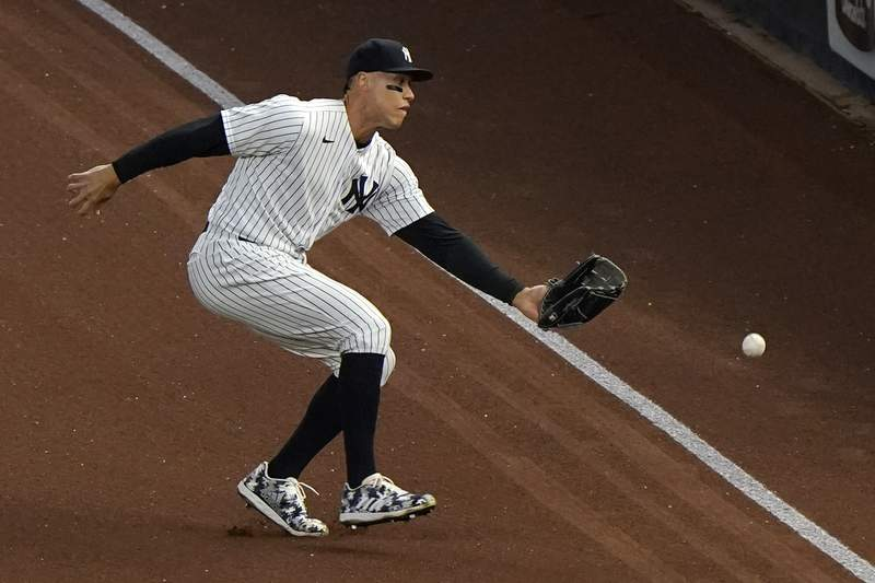 New York Yankees right fielder Aaron Judge fields Baltimore Orioles Trey Mancini's third inning ground rule double in a baseball game, Tuesday, April 6, 2021, at Yankee Stadium in New York. (AP Photo/Kathy Willens)
