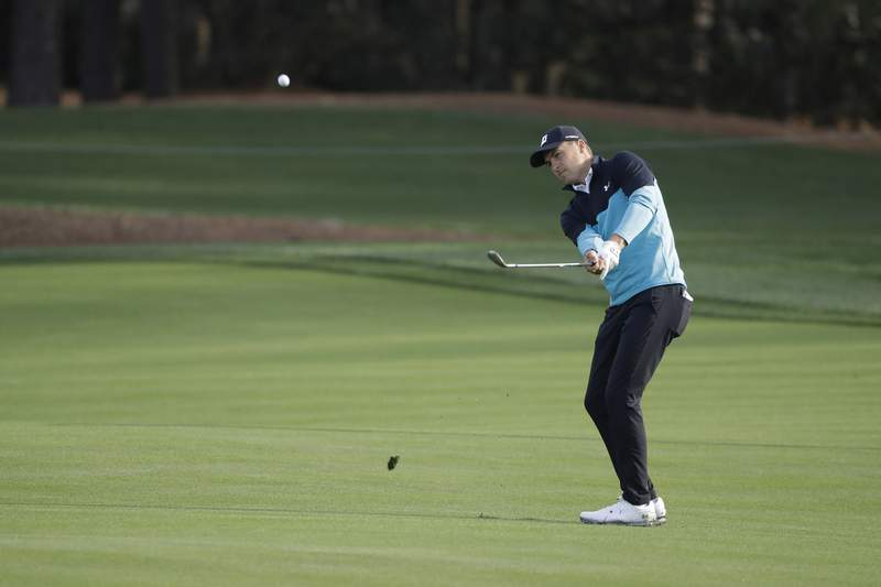Jordan Spieth hits from the 11th fairway, during the first round of The Players Championship golf tournament Thursday, March 12, 2020, in Ponte Vedra Beach, Fla. (AP Photo/Chris O'Meara)