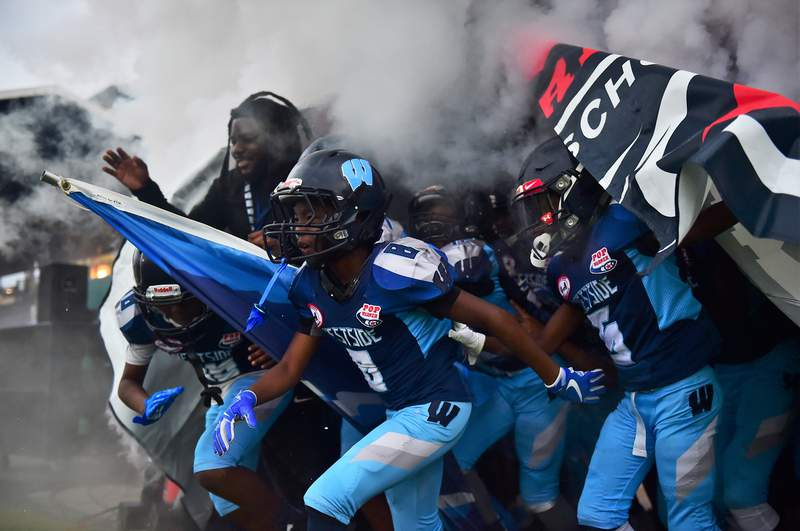 Members of the Westside Wildcats run out of the tunnel during the Division II Junior Pee Wee Super Bowl last December in Orlando.