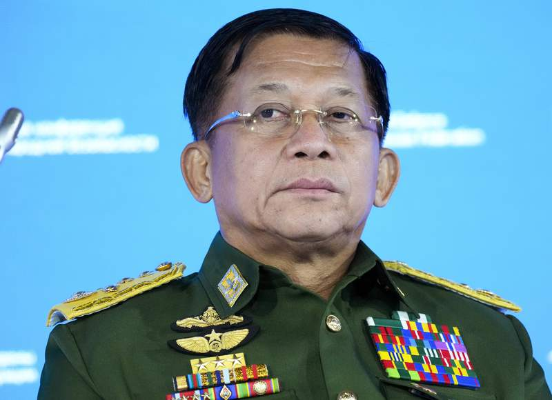 FILE - In this June 23, 2021, file photo, Commander-in-Chief of Myanmar's armed forces, Senior General Min Aung Hlaing delivers his speech at the IX Moscow conference on international security in Moscow, Russia. Six months after seizing power from the elected government, Myanmars military leader on Sunday, Aug. 1, 2021, repeated his pledge to hold fresh elections in two years and cooperate with Southeast Asian nations on finding a political solution for his country. (AP Photo/Alexander Zemlianichenko, Pool)