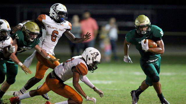 Fleming Island running back Timothy Thomas breaks free from Atlantic Coast defenders in the first quarter of a 2019 game. (Ralph D. Priddy, Contributed photo)