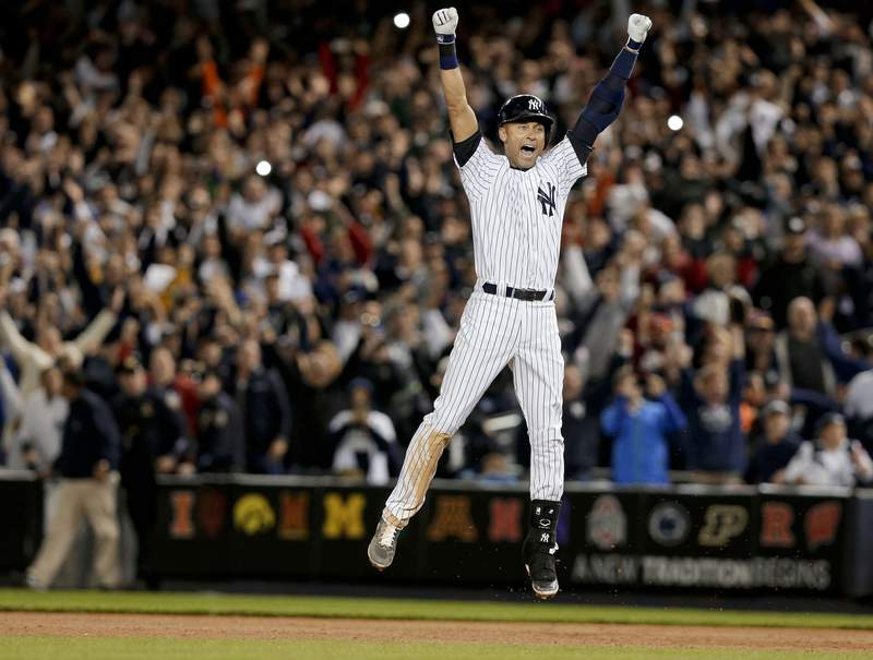 In this Sept. 25, 2014, file photo, New York Yankees' Derek Jeter jumps after hitting the game-winning single against the Baltimore Orioles in the ninth inning of a baseball game, in New York. Jeter is among 18 newcomers on the 2020 Hall of Fame ballot. On Tuesday, Jan. 21, the Baseball Writers' Association of America will announce the results of its 2020 Hall of Fame balloting. (AP Photo/Julie Jacobson, File)