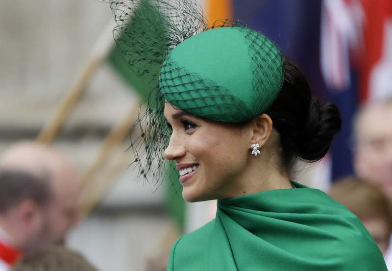 FILE - In this Monday, March 9, 2020 file photo, Britain's Meghan, the Duchess of Sussex leaves after attending the annual Commonwealth Day service at Westminster Abbey in London. A British judge on Wednesday Aug. 5, 2020, has ruled that the Duchess of Sussex can keep her friends names secret while she brings a privacy-invasion lawsuit against a British newspaper. (AP Photo/Kirsty Wigglesworth, File)
