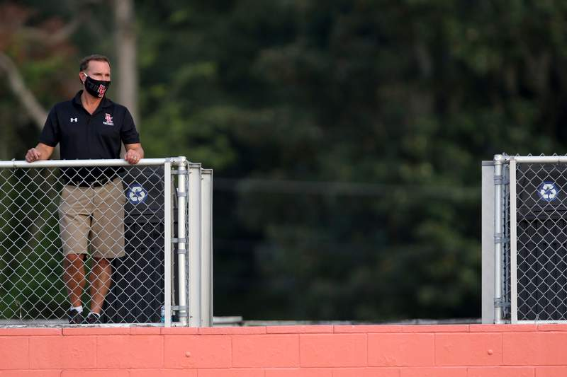 Jacksonville Mayor Lenny Curry watches a high school football football scrimmage between the Bolles Bulldogs and Bishop Kenny Crusaders at Skinner-Barco Stadium in Jacksonville, FL, Friday September 4, 2020.