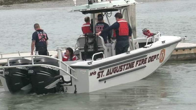 A still image from a video shows the St. Augustine fireboat coming to the Vilano boat ramp with two of the rescued boaters.