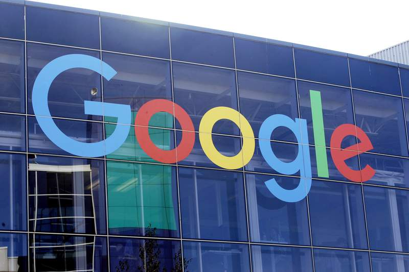 FILE - In this Sept. 24, 2019, file photo a sign is shown on a Google building at their campus in Mountain View, Calif. Google is formally pushing back on antitrust claims brought against it by the Justice Department two months ago. In a legal filing with the U.S. District Court for the District of Columbia, Google generally denied the legal claims against it and said that people use its search engine because they choose to, not because they are forced to or because they cannot easily find alternative ways to search for information on the Internet. (AP Photo/Jeff Chiu, File)