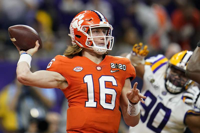 Clemson quarterback Trevor Lawrence passes against LSU during the first half of a NCAA College Football Playoff national championship game Monday, Jan. 13, 2020, in New Orleans. Georgia Tech will play at home against the nation's top-ranked team for the first time in 40 years when No. 1 Clemson, let by the high-profile tandem of quarterback Trevor Lawrence and running back Travis Etienne, puts its perfect record on the line on Saturday, Oct. 17. (AP Photo/David J. Phillip, File)