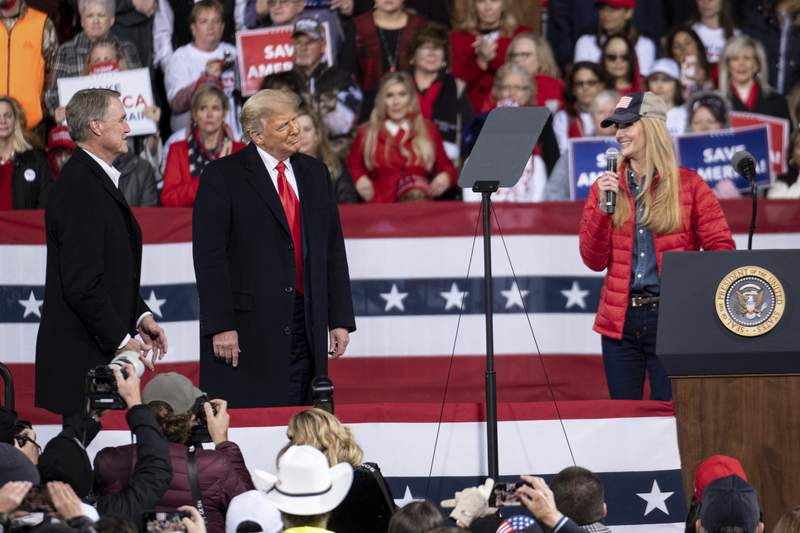 President Donald Trump shares the stage with U.S. Sens. Kelly Loeffler, R-Ga., and David Perdue, R-Ga., who are both facing runoff elections Saturday, Dec. 5, 2020 during a rally in Valdosta, Ga. (AP Photo/Ben Gray)