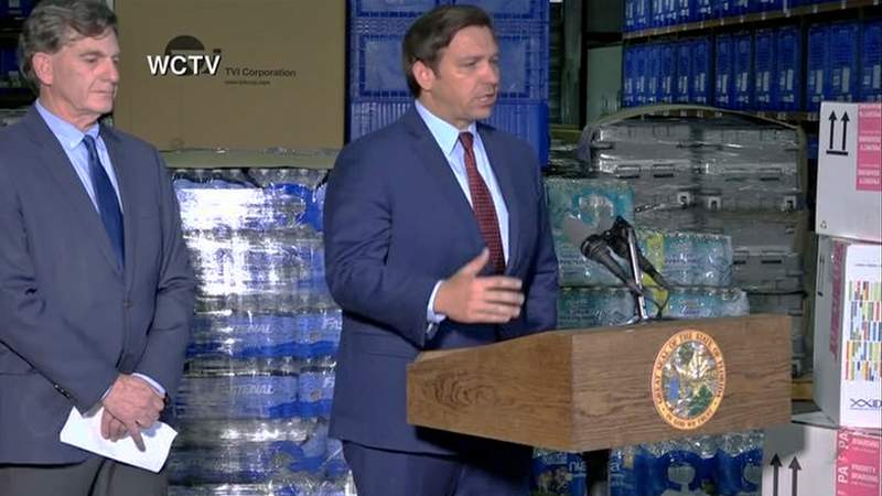 Gov. Ron DeSantis and Florida Surgeon General Dr. Scott Rivkees address the media Friday from the Florida Department of Health warehouse.