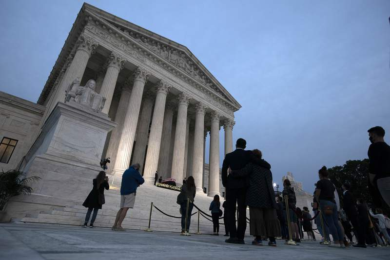 Mourners pay respects as Justice Ruth Bader Ginsburg lies in repose under the Portico at the top of the front steps of the U.S. Supreme Court building on Thursday, Sept. 24, 2020, in Washington. Ginsburg, 87, died of cancer on Sept. 18. (AP Photo/Jose Luis Magana)