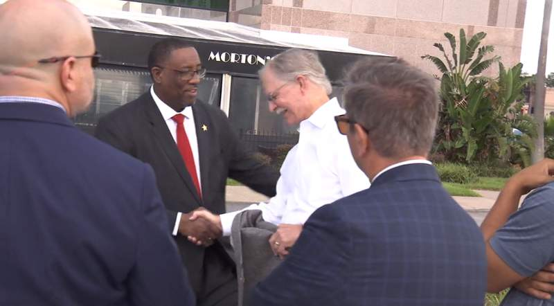Sheriff's candidate T.K. Waters (left) shakes  hands with Rep. John Rutherford.