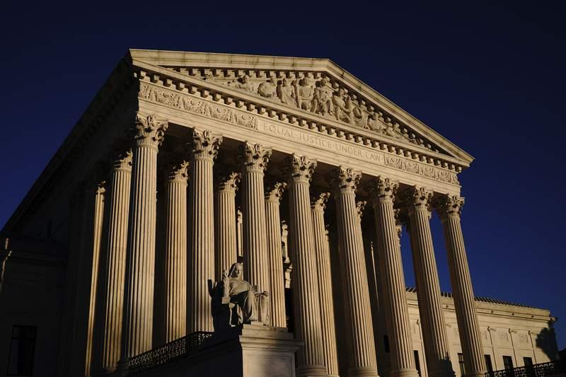 FILE - In this Nov. 2, 2020, file photo the Supreme Court is seen at sundown in Washington.   (AP Photo/J. Scott Applewhite, File)